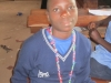 Een kind op de school van Serve Direct, Uganda